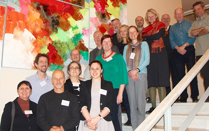 Members of the Expert Group pose on a stair case